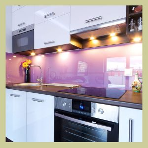 kitchen dressed up with a purple backsplash